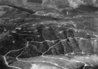 Aerial View – Clearcuts and logging roads outside impact area- approx. 20 miles W. of Mt. St. Helens, Wash., 1982