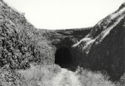 """Spokane, Portland, and Seattle #5 (tunnel), 1996 Gelatin silver print mounted to 16 x 20"""" archival board, with graphite lettering 8 x 10 inches"""