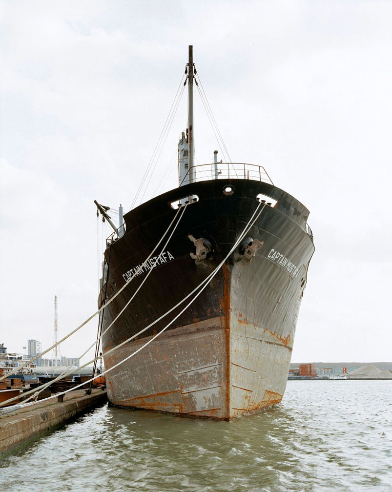 Large black and brown cargo ship