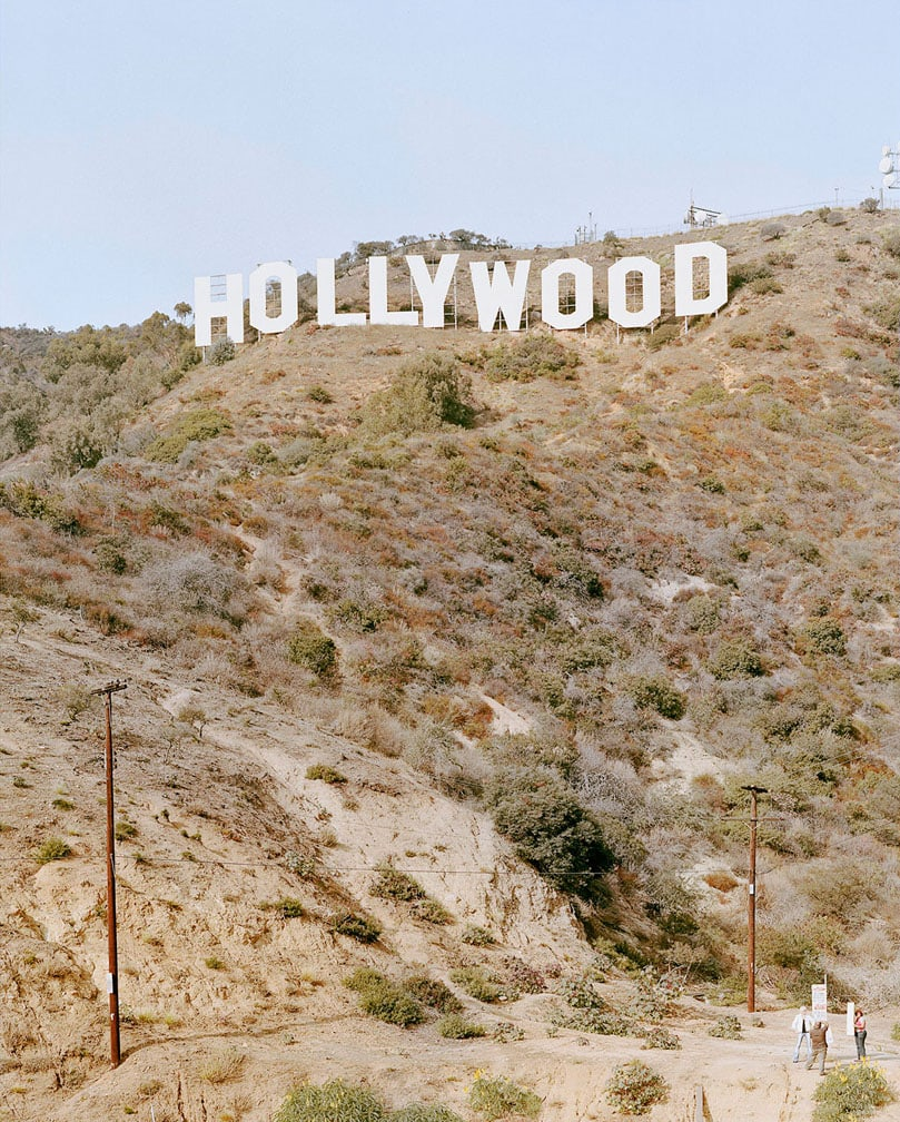 Tourists taking a photo at the bottom of the Hollywood sign