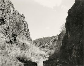 Dirth path with long grass on both sides between rock pass, Mark Ruwedel, Pictures of Hell