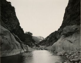 Wide river with smooth rock sides moving through a mountain pass, Mark Ruwedel, Pictures of Hell